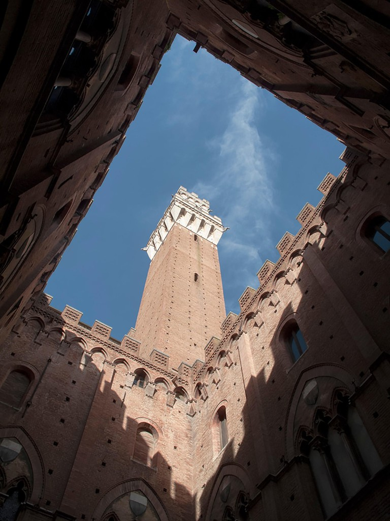 The Mangia Tower, Torre del Mangia in Siena in Italy