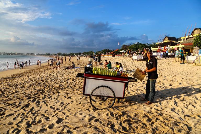 A Hawker in Jimbaran Beach in Bali © DavidNNP / Shutterstock