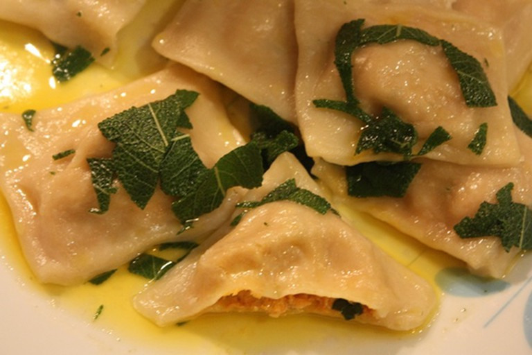 Pumpkin and cashew-cheese stuffed ravioli in sage-butter