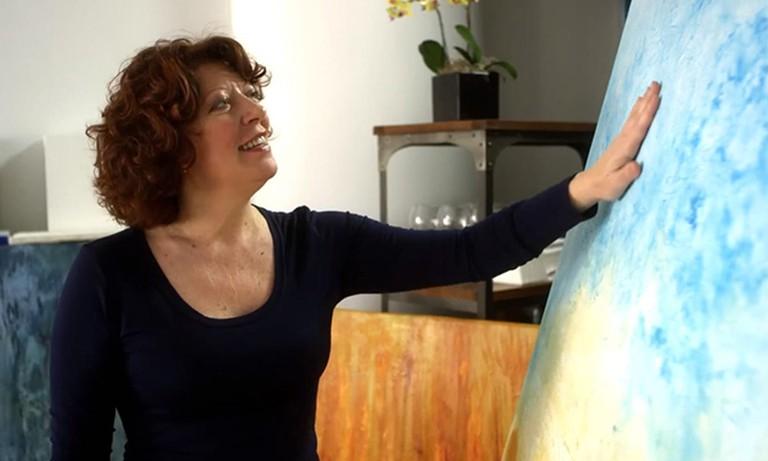 Clara Berta with Artwork | Courtesy of Clara Berta