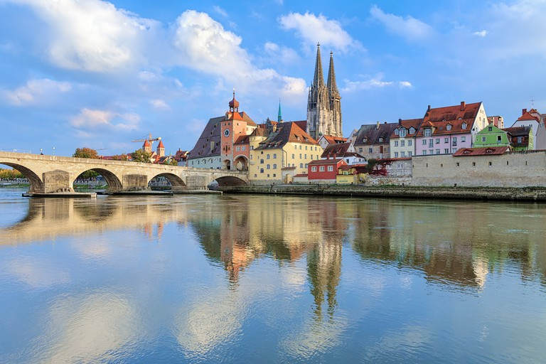 View from Danube on Regensburg Cathedral and Stone Bridge in Regensburg, Germany | © Mikhail Markovskiy/Shutterstock