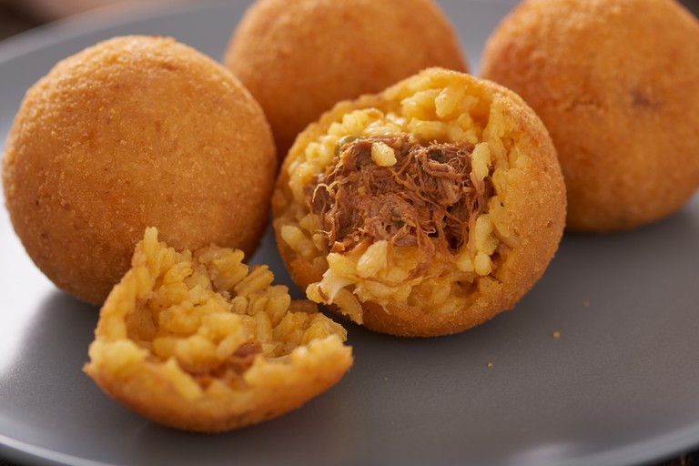 Arancini (deep fried rice balls with meat) Typical Sicilian street food | © Antonio Danna / Shutterstock