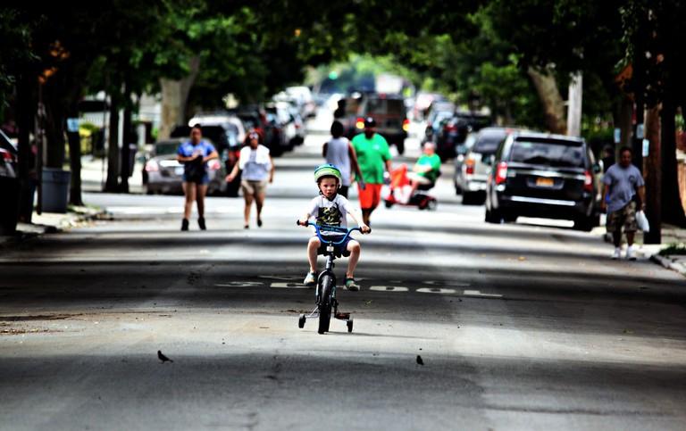 Boy racing his bike in Marine Park Brooklyn | Dan M. Lee Photography