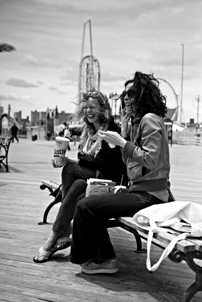 Friends meet on Coney Island's Boardwalk | Dan M. Lee Photography