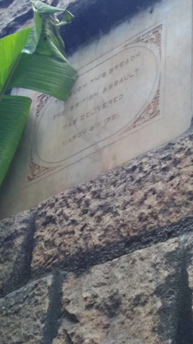 Tablet on the wall of the fort indicating Lord Cornwallis' breach | © Annu Kaushik