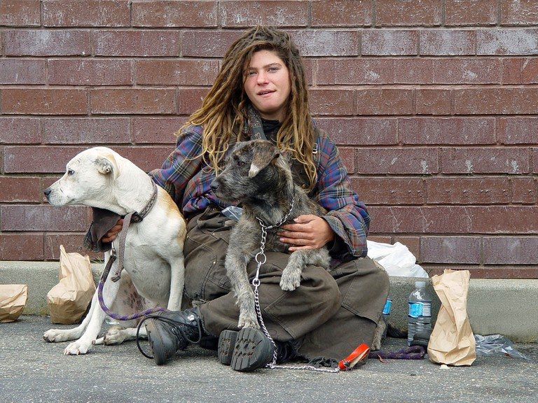 Homeless woman with dogs © Franco Folini/Flickr