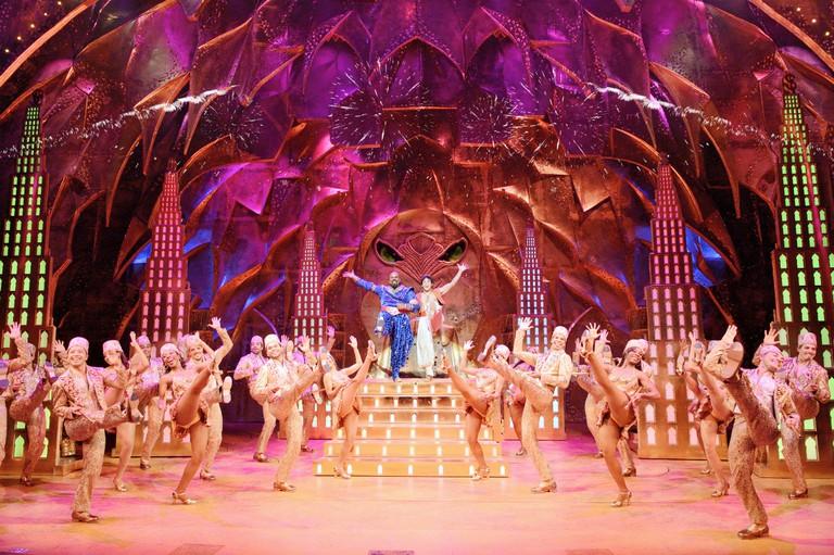 James Monroe Iglehart (Genie) and Adam Jacobs (Aladdin) with the company of the Broadway production of Disney's Aladdin   © Deen Van Meer