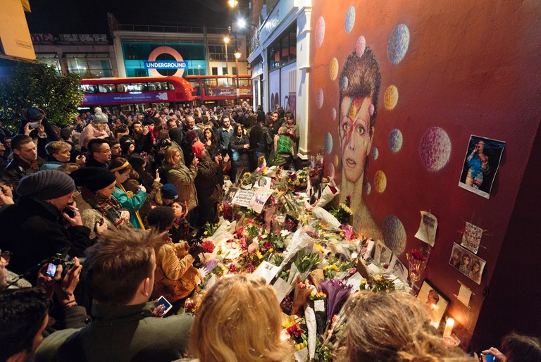 Mourners gather at the Bowie memorial in Brixton