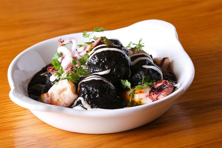 Albondigas en Tinta con Calamares. Pork Meatballs, Squid Ink, Seared Baby Squid, Garlic Aioli, Picada | Image Courtesy of Boqueria NYC