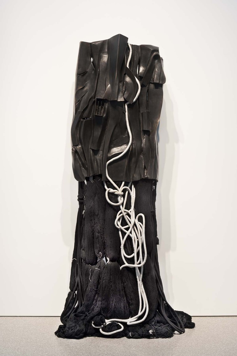 "Barbara Chase-Riboud (b.1939) Malcolm X #13, 2008 black bronze, silk, wool, linen, and synthetic fibers 86"" x 36"" x 25 1/2"" Credit Line: Courtesy of Michael Rosenfeld Gallery LLC, New York, NY"