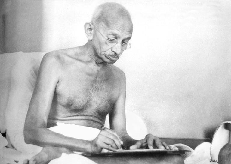 Gandhi writing at Birla House, Mumbai, August 1942   © Kanu Gandhi/WikiCommons