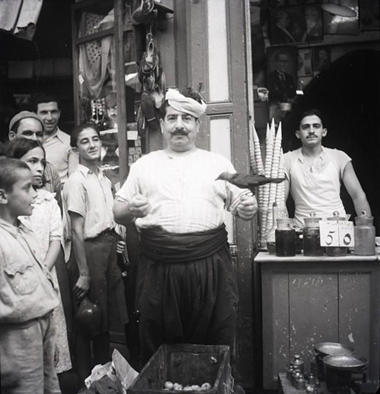 Hanna Safieh. The ice cream seller with his bird, 1940s. Rafi Safieh Collection