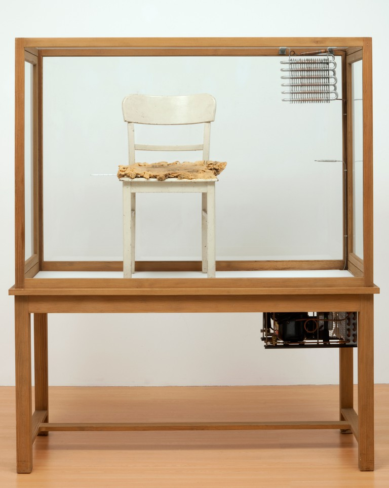 Joseph Beuys, Fettstuhl (Fat Chair), 1964 – 1985, Sculpture (Wood, glass, metal, fabric, paint, fat and thermometer), 183 x 155 x 64 cm, ARTIST ROOMS National Galleries of Scotland and Tate. Acquired jointly through The d'Offay Donation with assistance from the National Heritage Memorial Fund and the Art Fund 2008
