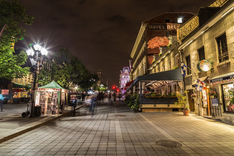 Old Town Montreal at night showing the blur of people. © Mikecphoto / Shutterstock