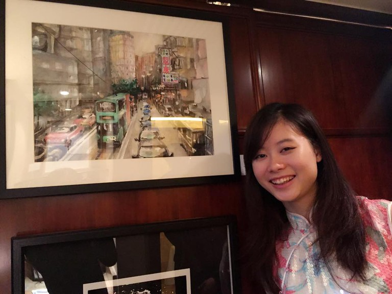 Elaine with her art work at the Asia Contemporary Art Show.