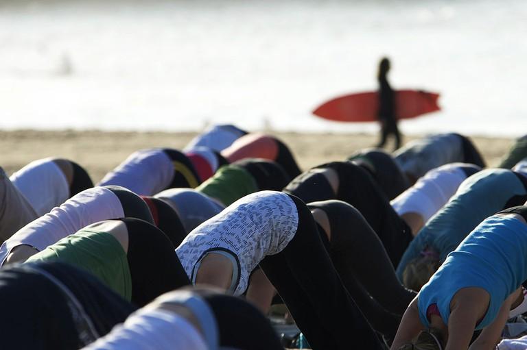 1200px-Yoga_At_Dawn_on_Bondi_Beach