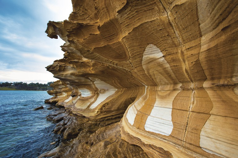 Maria Island Walk, Painted Cliffs, Maria Island, TAS | Courtesy of Maria Island Walk / Great Walks of Australia © Graham Michael Freeman