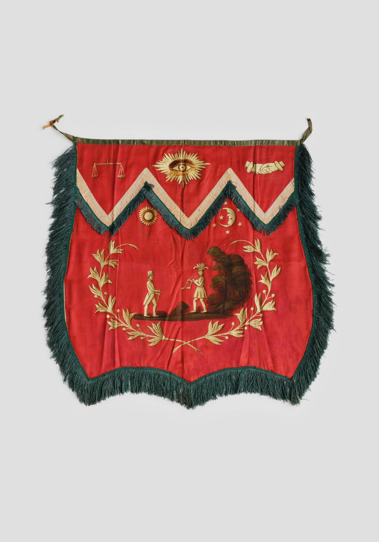 """Fraternal Apron Artist unidentified United States 1825–1850 Paint and gold paint on silk satin, with silk ribbon and silk fringe; cotton back 19 1/2 x 19"""" Collection American Folk Art Museum, New York Gift of Kendra and Allan Daniel, 2015.1.93 Photo by José Andrés Ramírez"""