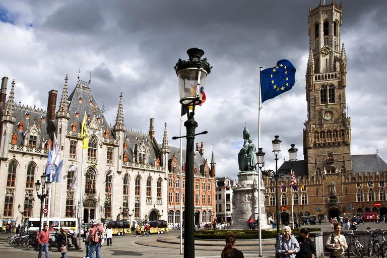 Bruges' main market square with Belfry on the right | © Strange Luke/Flickr
