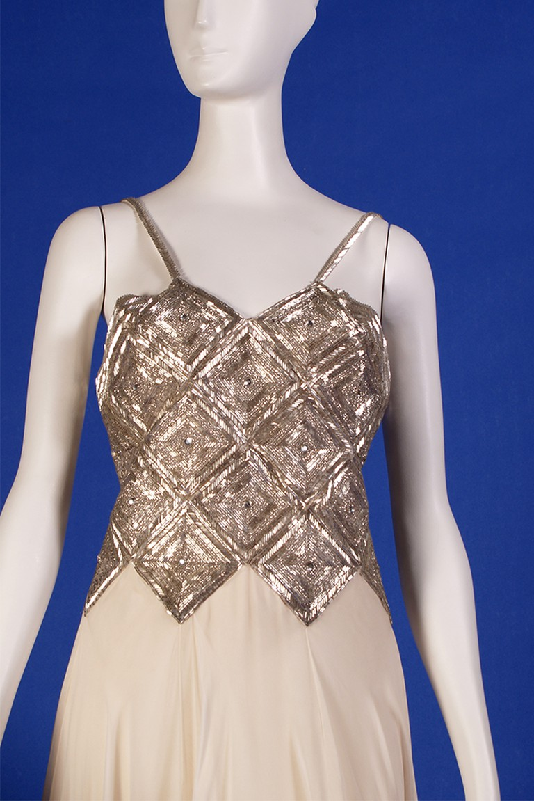Cream silk chiffon dress with geometric beaded bodice, design by Stavropoulos| © Courtesy of Kent State University Museum