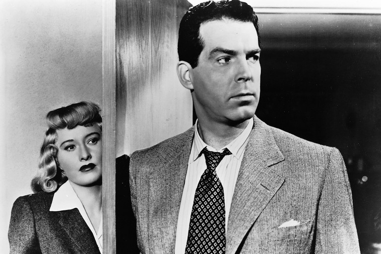 """This undated publicity photo,provided by Universal Studios Home Entertainment, shows actors Fred MacMurray and Barbara Stanwyck in the 1944 noir film """"Double Indemnity."""" The movie was released on DVD, in a two–disc version, in August 2006. (AP Photo/Universal Studios Home Entertainment)"""