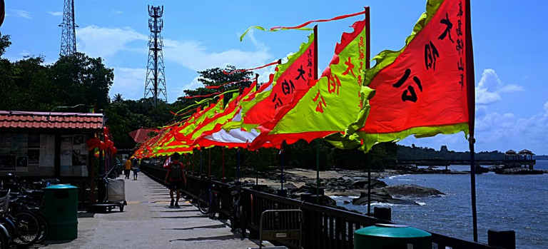 Colourful flags greet visitors at the Pulau Ubin Jetty © Prianka Ghosh