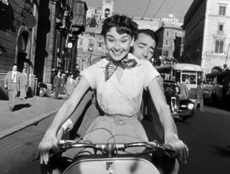 https://commons.wikimedia.org/wiki/File:Audrey_Hepburn_and_Gregory_Peck_on_Vespa_in_Roman_Holiday_trailer.jpg