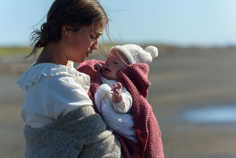 Isabel (Alicia Vikander) and the foundling. (© Touchstone Pictures)