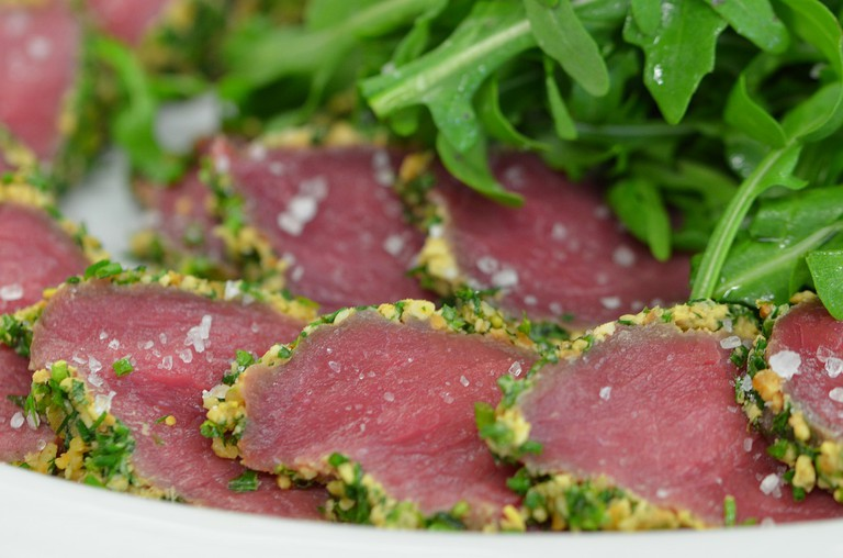 Some restaurants serve game meat, such as springbok, as carpaccio