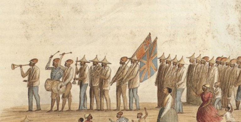 An illustration of freed slaves celebrating with ghoema-style drums and shakers © Meltzer et. al., 2012 Ghoema and Glitter: New Year Carnival in Cape Town. Iziko Museums / WikiCommons