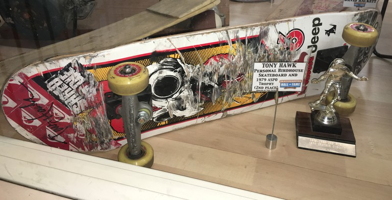 Legendary skateboarder and Hall of Fame inductee Tony Hawk's old skateboard and a rare second-place trophy Hawk donated to Skatelab | Courtesy of Stephen A. Cooper