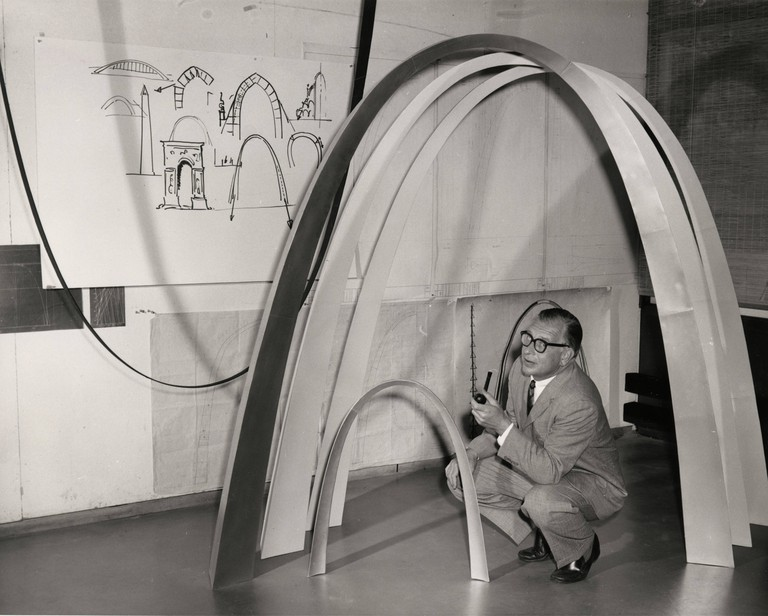 Eero Saarinen with model and sketches of St. Louis' Gateway Arch, ca. 1958. Credit: Manuscripts & Archives, Yale University Library