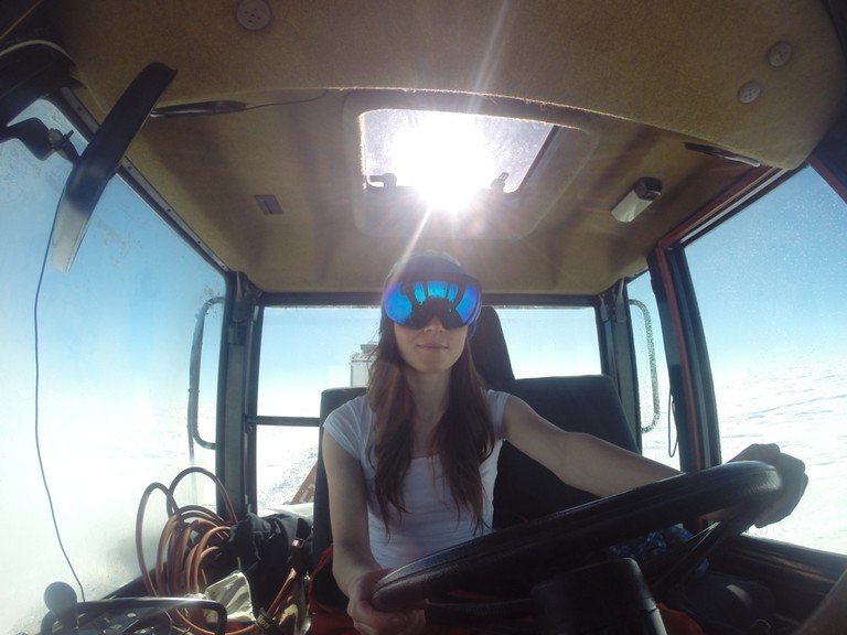Beth drives a CAT tractor as part of an IPEV overland traverse |©Beth Healey