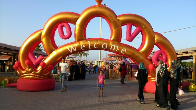 Entrance to one of many pop-up fun fairs during Eid.   © Sarah Elmusrati