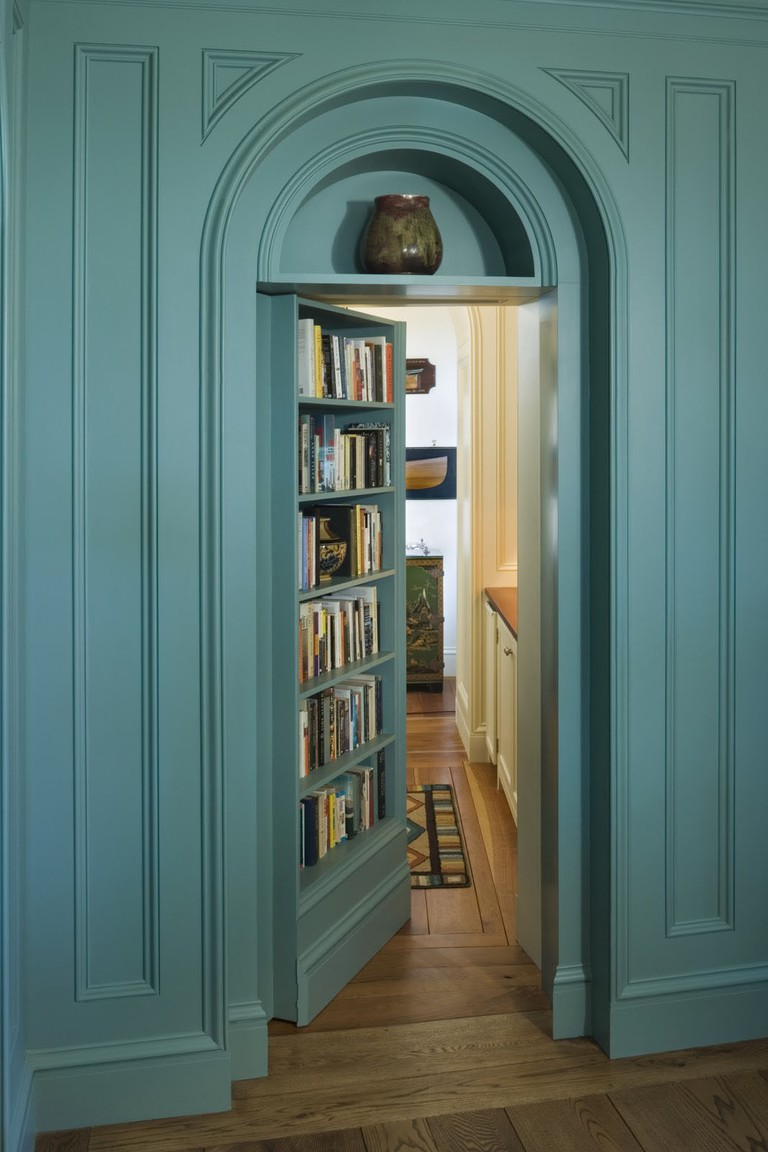 Hidden door bookshelf by Peter Penner Architects