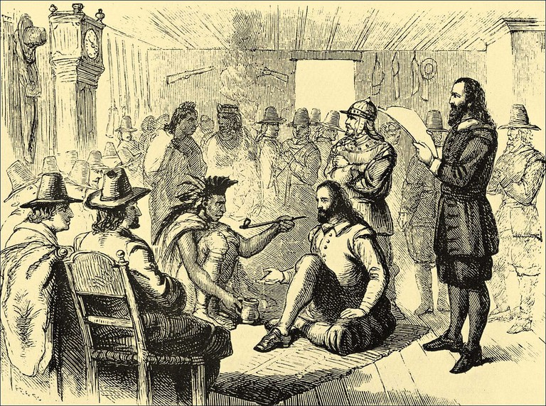 Massasoit smoking a peace pipe with Governor John Carver in Plymouth Colony 1621 | Public Domain/WikiCommons