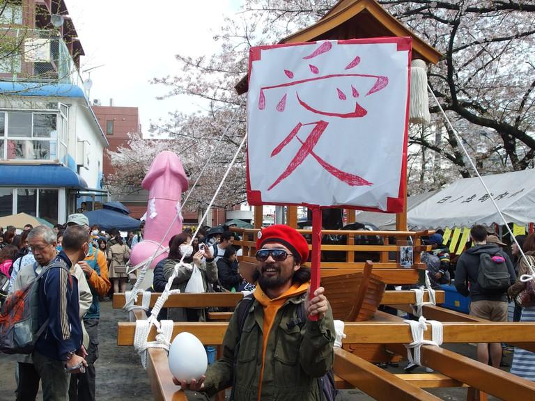 "Kanamara Festival. The sign says ""love""   © Guilhem Vellut/Flickr"