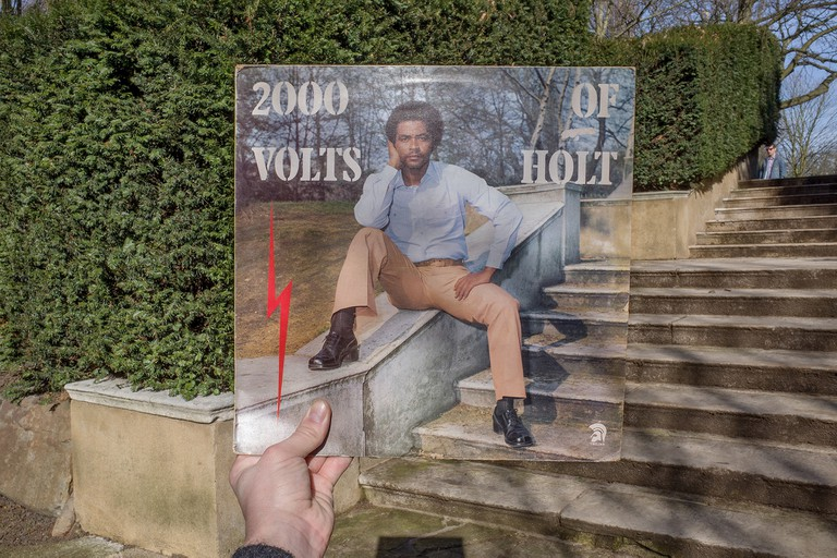 John Holt, 2000 Volts of Holt (Trojan Records, 1976), rephotographed in Holland Park, London W14, 39 years later. © Alex Bartsch