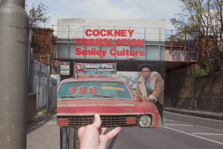 Smiley Culture, Cockney Translation (Fashion Records, 1984), rephotographed on Plough Road, London SW11, 32 years later. © Alex Bartsch