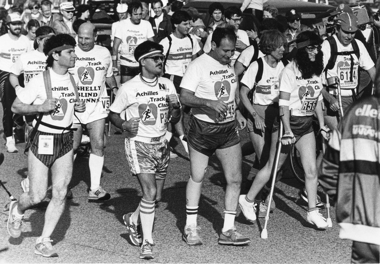 Dick Traum (center) running the 1986 NYC Marathon with members of Achilles Track Club (now known as Achilles International). | © Courtesy of Achilles International