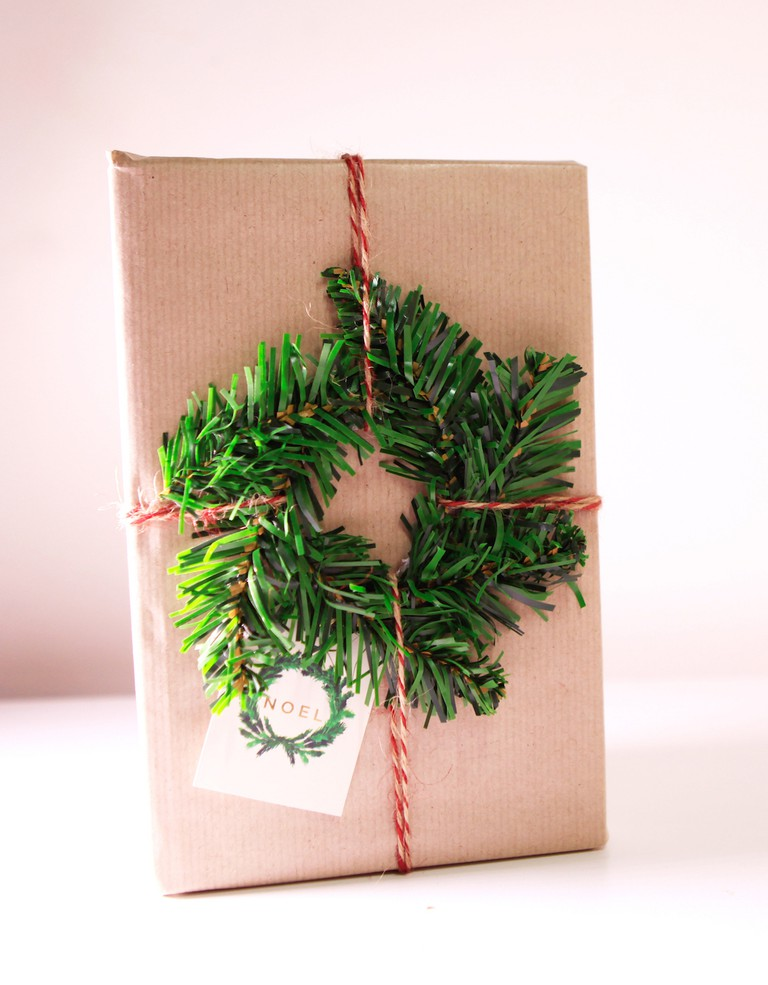 Check out how to make this mini wreath gift wrap in our video tutorial here