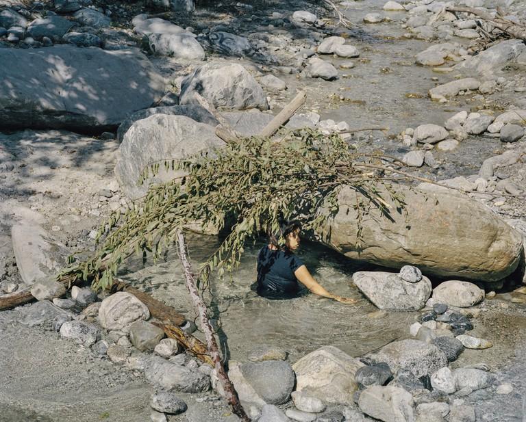 Mustafah Abdulaziz, Makeshift water pool in dry creek bed. Highway 38, San Bernardino County, Calfornia, USA, 2015