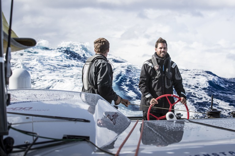 Rome Kirby and Shannon Falcone stare down a 7 meter wave. © Red Bull Media House