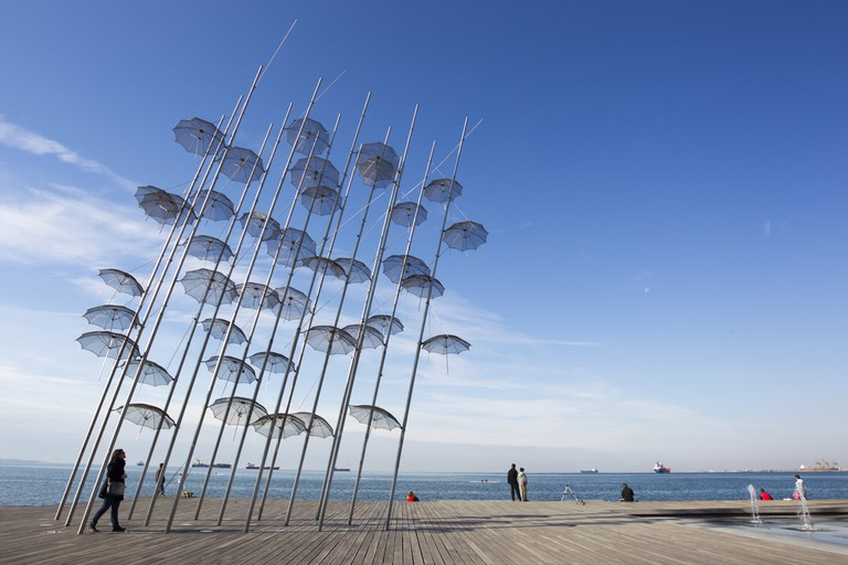 People are enjoying the sunny weather near seaside in Thessaloniki