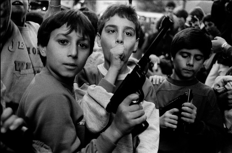 Day of the dead festival. Children playing with arms, Palermo, 1986
