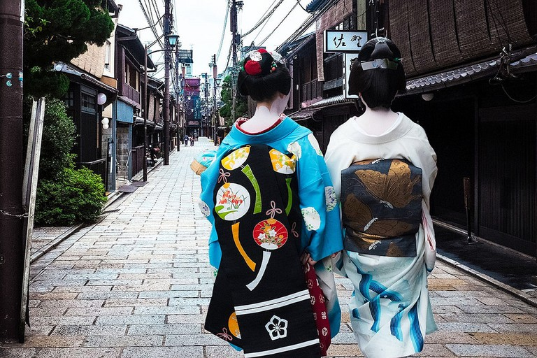 Geiko wearing elaborate kimono, Kyoto