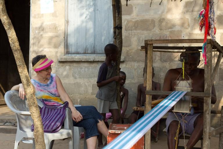 A weaver operating a tradional loom © Chad Skeers / Flickr