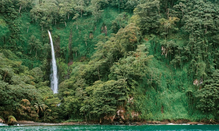 "Waterfall into the Pacific/<a href=""https://www.theguardian.com/environment/2014/may/08/cocos-islands-rich-pirate-history"" target=""_blank"">Robert Wu</a>/Corbis"