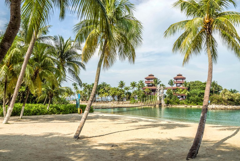 Palawan Beach and the bridge to most southern point of continental Asia on Sentosa Island, Singapore