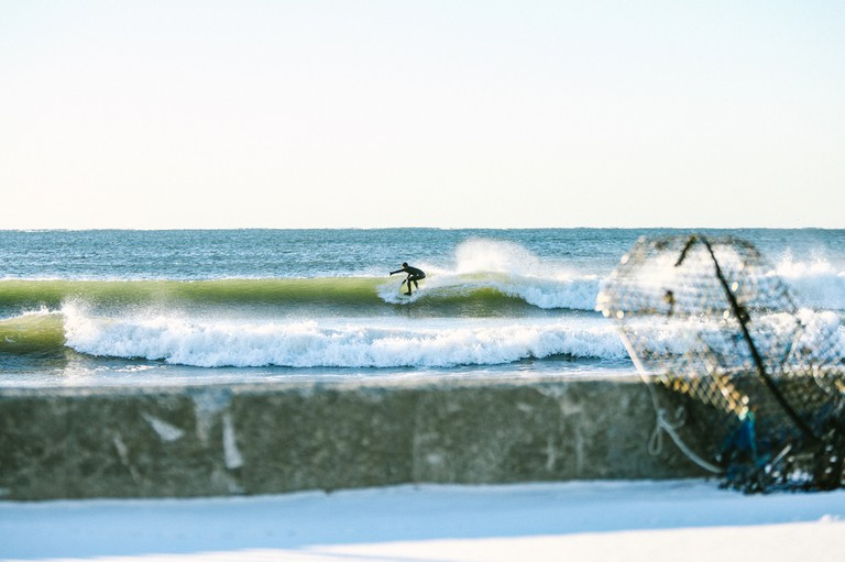 More affordable wetsuits and weather-forecasting technology have increased winter surfing in Maine | © Corey McKenna